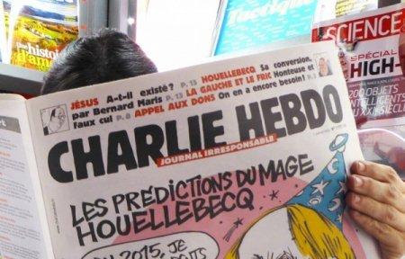 Charlie Hebdo опубликовал карикатуру Башара Асада с прищепкой на носу